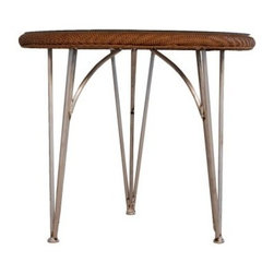 Lloyd Flanders Mod All-Weather Wicker 34 in. Patio Bistro Table - Why is it that every outdoor coffee shop has all-weather bistro tables that look like they're stamped out of bland metal when they could have the Lloyd Flanders Mod All-Weather Wicker 34 in. Patio Bistro Table? The slender legs are all about modern style, but the woven top of resin wicker gives it a classic touch and pleasant, homey texture. The aluminum frame is naturally rust-resistant and finished in your choice of powder-coated colors. The single sheet of shatter-resistant glass adds a polished look and when paired with the moisture-proof resin wicker, you've got a combination that's as tough as it is low-maintenance.About Lloyd/FlandersCarrying on the traditions of Marshall B. Lloyd, Lloyd/Flanders brings the sophistication of timeless furniture designs to a sophisticated, modern audience. Using modern production processes and materials, these classic styles are faithfully rendered in a way that can be enjoyed by customers anywhere with high-quality construction and reliable, all-weather designs.