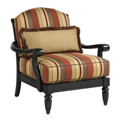Tommy Bahama by Lexington Home Brands Kingstown Sedona Lounge Chair - Richly colored and surprisingly grand in style, the Tommy Bahama Kingstown Sedona Lounge Chair blurs the lines between indoor elegance and contemporary outdoor living. As part of Tommy Bahama's unique Kingstown Sedona collection, this beautiful chair is cast from a hand-carved aluminum frame mold, which allows for much greater depth and design detail than ordinary patio furniture can muster. The evidence lies in its Tuscan-inspired design, which features an interlocking scrollwork back, scrolled arms, and fluted front legs, in a rich ebony finish with bronze highlights. The red rocks of Sedona, Arizona, provide another regional inspiration - in this case, the autumnal hues of its high-performance, water-resistant cushion set, which includes a Weatherguard™ kidney pillow for back support. With its relaxed approach to the finer things in life, this exceptional lounge chair would make a perfect addition to your well-appointed patio or outdoor living room.About Tommy BahamaTommy Bahama brings extraordinary craftsmanship and design sophistication to contemporary outdoor living. Painstakingly handcrafted, globally inspired, their themed patio furniture collections feature the finest materials, performance fabrics, and artisan finishes, transforming outdoor spaces into natural extensions of indoor rooms. Tommy Bahama is part of the family of Lexington Home Brands, which is headquartered in High Point, North Carolina. Founded in 1903, Lexington is respected throughout the industry for its innovative, award-winning designs and commitment to exceptional quality. With Tommy Bahama, that means details such as handwoven all-weather wicker and precision-welded aluminum frames, creating a luxurious patio paradise of casual elegance and uncompromising quality.