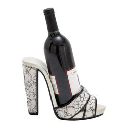 "Benzara - Elegant Shoe Wine Holder with Beautiful Stiletto Design - This elegant and sturdy shoe wine holder is the stylish way to store and showcase your favorite wine. With excellent design befitting an antique piece, this high quality wood of this cabinet is shaded in natural hue and the borders are well defined and crafted expertly. The top surface is especially finished to hold wine glasses and presentation trays comfortably at the appropriate height. This wine holder offers the best utility in terms of storing essentials needed for drink sessions. The holder is so ergonomically designed that it becomes easy to store and take out wine bottle whenever necessary. The contrasting colored edges and the hinges of the rack make the wine holder more prominent and visually appealing. The wine holder specially crafted to hold wine bottles both in the upright position. This wine holder is the perfect choice to securely and stylishly store your wine bottles. Made from a high quality polystone material, it will last for long.; Excellently designed wine cabinet; High quality polystone finished in antique style; Special shelves for wine bottles; Spacious utility rack; Weight: 17.64 lbs; Dimensions:11""W x 4""D x 6""H"