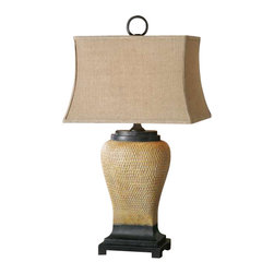 Uttermost Melitta Ceramic Table Lamp - Pitted ceramic base finished in caramel undertones with a light gray wash, pale yellow highlights and aged black accents. Pitted ceramic base finished in caramel undertones with a light gray wash, pale yellow highlights and aged black accents. The rectangle bell shade is a coarse weave burlap fabric.