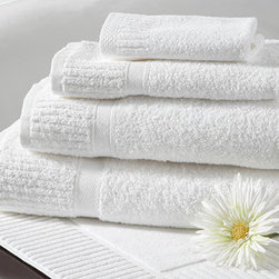 """Grande Hotel Towels - Luxe white hotel towels say """"vacation"""" to us all. Add this set to your own home for a vacation feel. I also love that they are easy to care for with bleach."""