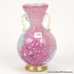 """Murano Glass Vases - The gorgeous Venetian vase is a true work of Art created by the hands of Murano Glass masters. This Murano vase features beautiful colors and a pattern of stylized flowers created using famous Murano Millefiori technique (the name means """"a thousand flowers"""" in Italian), which was invented by talented Murano Glass makers centuries ago. To achieve this look hundreds of unique colorful millefiori glass pieces are picked out by hand and fused together under high temperature in a special furnace. The amazing look of millefiori glass is further enhanced by the exquisite form of the vase and by the elegant 24K gold-lined decorative handles. The translucent base of the vase is also richly lined with 24K gold."""