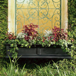 """Grandin Road - Devon Window Box - Carefully crafted from double-walled polyethylene. Planter looks like wood but doesn't chip, crack, or peel. Features a built-in system to help prevent over-watering. Simply hose off the planter when it needs to be cleaned. Includes a bracket and hardware for mounting to a wall. """"Spend more time enjoying your blooms and less time watering. Devon Planters practically water themselves."""" — Grandin Road Editors A Grandin Road exclusive, our handsome Devon Window Box provides the perfect showcase for your spring blooms. This timeless window box has the classic look of wood without the maintenance worries.. . . . ."""