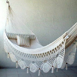 Couples Nicamaka - I love the crochet design that is hanging down from this hammock. It makes it all seem so airy.