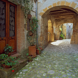 Murals Your Way - Cobblestone Passage, Tuscany Wall Art - Sunlight dabbles a stone-floored passage, under arches of brick and stucco