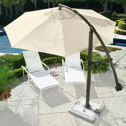 Cantilever Umbrella - This umbrella rocks on so many different levels. It's huge, easy to move around with built in wheels and has a cantilever that moves it up and down. You also get the benefit of all its shade. Perfect for a pool deck.