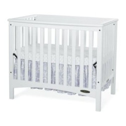 Child Craft - Child Craft London Euro 2-in-1 Mini Crib in White - This trendy 2-in-1 London mini crib features European styling and clean lines, and converts easily into a twin bed when your child is ready.