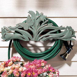 Butterfly Wall Mounted Hose Holder - Extend your love for butterflies to your gardens decor with our beautiful wall mounted hose holder. This hand cast sculpture features cattails and flowers that seem to sway gently as butterflies softly alight. The sturdy wall mounts and support tubes prevent hoses from kinking and help keep your yard tidy. As attractive as it is functional this decorative hose holder is like artwork for your home. Crafted of rust-free recycled aluminum for its light weight and durability this decorative hose holder is available in your choice of four all-weather finishes; Black, French Bronze, Moss Green and Verdigris. Holds up to 150 feet of hose and can be easily mounted to wall or post.