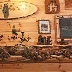 Hand Carved Rustic Log Mantel - The artisans of Woodland Creek Furniture hand carved log mantels with the scene of your choice to the desired length. Visit our web site to see examples of additional scenes.  Each is also hand painted and a work of art.  The bears in this mantel are 3D and appear to be jumping out of the log.
