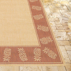 Frontgate - Oasis Retreat Outdoor Rug in Brown & Terra Cotta - Made from 100% fiber-enhanced Courtron  polypropylene. All-weather rug construction is pet-friendly and mold- and mildew-resistant. Power-loomed flat weave makes it suitable for both indoor and outdoor use. Adds warmth underfoot in cooler temperatures and relief from hot surfaces in summer. Simply hose off outdoor rug to clean. Our Oasis Retreat Outdoor Rug features a solid center panel, artfully surrounded by a pattern of pineapple outlines. Distinctively designed to complement classic outdoor decor, this versatile floor covering is ideal for patios, entryways, and sunrooms.Made from 100% fiber-enhanced Courtron polypropylene. . . . . Made in Belgium.