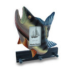 Zeckos - Colorful Wooden Bass Shaped Decorative Hanging Photo Frame and Wall Hooks - Show off your favorite 'catch' with this wooden fish shaped photo frame that doubles as a coat, hat, leash or key hanger with 3 wooden pegs across the bottom. Perfect in a beach, nautical or underwater themed room, this 12 1/4 inch high, 10 7/8 inch wide, 2 inch deep (31x28x5 cm) wall hanging accommodates 3.5 x 5 inch photos while the glass insert protects it from dust and 'fishy fingers'. It boasts a colorful hand-painted finish, and a bass seemingly jumping out of blue waters. It's a fun way to give the gift of 'you', or at least a picture of you, to any fans of the deep blue sea