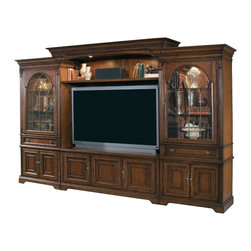 """Hooker Furniture - Brookhaven Home Theater Group - 65"""" Console - White glove, in-home delivery included!  Includes furniture assembly!  Highly Distressed Medium Clear Cherry Finish.  The Brookhaven Home Theater Group with the 65"""" Console will accommodate up to a 65-inch television.  Be sure to measure your TV before purchasing.  Theater Group Consists of: Left and Right Pier Cabinets, 65"""" Entertainment Console, Back Panel, Light Bridge and Shelf   Left Pier Cabinet: Top section - one wood-framed glass door with inlaid v-grooved antique brass finish, canister light controlled by three-intensity touch switch on right pier cabinet, two adjustable glass shelves, one drawer; Bottom section - two doors with interchangeable wood/speaker cloth panels open to reveal one adjustable shelf, levelers, stained top.  38 1/4"""" w x 24"""" d x 82"""" h  Drawer: 27 1/4"""" w x 16 1/4"""" d x 4 5/16"""" h   65"""" Entertainment Console: Two outside doors with interchangeable wood/glass panels open to reveal one adjustable shelf behind each door, center door with interchangeable wood/speaker cloth panels opens to reveal one adjustable shelf behind door, touch latch operation, three plug outlet, levelers, finished top.  Console is not intended to be used alone.  65"""" w x 25 1/4"""" d x 26"""" h  Behind Center Door: 19 13/16"""" w x 20"""" d x 18"""" h  Left and Right Shelves: 21"""" w x 17 1/2"""" d   Back Panel: 65 3/4"""" w x 1 1/4"""" d x 57"""" h   Light Bridge: Two canister lights controlled by three-intensity touch switch on right pier. Stained top.  80 1/4"""" w x 27"""" d x 8 1/2"""" h   Shelf: 64 3/4"""" w x 19"""" d x 1 1/2"""" h   TV Area: 65' w x 20 3/4"""" d x 38"""" to 46"""" h"""