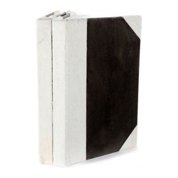 White Fur Journals  - Set of 2 - Achromatic and made with a mix of genuine hair-on leather and smooth faux hide, the White Hair Journals contrast their creamy, tactile spines with darker front and back covers for a noticeable neutral accessory.  Give an organic yet poised look to a desktop arrangement or confide your joys and sorrows in the blank pages of this pair of bound journals.