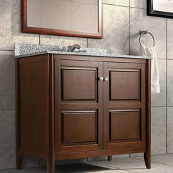 WOLF Bath Furniture: Pennfield Collection - The Pennfield Collection features a transitional vanity in a Tobacco finish with raised panel doors and rounded legs.