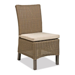 Thos. Baker - Sanibel Wicker Outdoor Side Chair - Crafted using fade-resistant nDuraA all-weather wicker hand-woven over powder-coated aluminum frames, each piece in the sanibel collection boasts a transitional style that compliments both contemporary and traditional outdoor spaces.Plush cushion sets are covered in premium Sunbrella outdoor fabrics made-to-order in your choice of 24 solid and textured colors or 16 premium woven patterns.Signature or premium cushion sales are final and ship in 2-3 weeks.