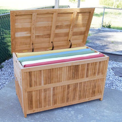 Jewels of Java - Jewels of Java Teak Cushion Box Multicolor - JW0278 - Shop for Sheds and Storage from Hayneedle.com! Chairs and tables for your patio aren't hard to find but attractive quality accessories like the Jewels of Java Cushion Box are as rare as they are necessary. You've gone to the trouble of outfitting your backyard environment but a visually pleasing way to organize is what you need next. Over 4 feet wide and 2 feet deep this solid teak box is the best way to hide your patio goods when they aren't in use. The attractive natural finish of tight-grained teak will fit in with any outdoor decor and you won't need to worry about weathering or warping due to the natural resilience of teak wood. Heavy-duty brass hinges and supports will withstand a whole summer's worth of openings and closings. Show everyone that you understand style and organization and then get back to lounging by the pool. Not recommended for seating. The Benefits and Beauty of TeakTeak wood is universally recognized for its quality durability and beauty. Teak is a very hard densely grained wood with high oil content. The unique combination of these characteristics makes teak naturally resistant to moisture rot warping shrinking splintering insects and fungus. It is considered the ideal wood for outdoor furniture. About Jewels of Java Teak FurnitureTeak furniture is a top choice for outdoor furniture as its average lifespan is 75 years! Untreated this beautiful hardwood holds up to season after season of any kind of harsh element. Putting Jewels of Java teak items into winter storage is unnecessary as this furniture resists water weather and warping as it mellows to a soft silver color. The grey/silver patina can be maintained by the application of teak oil once or twice a year although this only affects the color not the integrity of the wood and most prefer the look of fine aged teak. This high-grade teak comes from plantations in Indonesia and Jewels of Java is proud to work with Perum