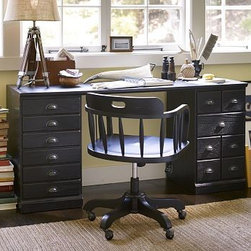"Printer's Desk Set, Artisanal Black stain - A vintage printer's cabinet with dozens of small drawers for storing type was the inspiration for our newest home office collection. Designed for ultimate versatility - at an exceptional value - its components can be combined in any configuration to create your perfect workspace. 64"" wide x 20"" deep x 30"" high The Desk Set includes one file cabinet pedestal, one cabinet pedestal, and one quadruple top. The file cabinet pedestal has three bluff-cut drawers; bottom drawer is fitted with rails for both letter- and legal-sized hanging folders. The cabinet pedestal has a bluff-cut door and two removable shelves. Pedestals are interchangeable and can be placed on either side of the desk as desired. The Tuscan chestnut finish is hand applied in layers, with distressing and burnished edges that give the collection the look of a well-loved antique. Fitted with antique bronze cup pulls. Wood swatches, below, are available for $25 each. We will provide a merchandise refund for wood swatches if they're returned within 30 days. Watch a video about the versatility of our {{link path='/pages/popups/printers_video_popup.html?cm_sp=Video_PIP-_-PBQUALITY-_-PRINTERS' class='popup' width='450' height='300'}}Printer's Collection{{/link}}. View our {{link path='pages/popups/fb-home-office.html' class='popup' width='480' height='300'}}Furniture Brochure{{/link}}."