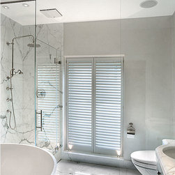 Frameless Shower Enclosures - Fully frameless heavy glass shower door, with partition area. Photo credit:  Alyce Porter