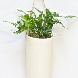 www.shopboxhill.com - HEMPSTER BLOOMER - The Hempster Bloomer, by Portland designer Zoë Umholtz. The Hempster Bloomer, a modern porcelain planter with a rustic twist. The clean lines of the vessel is accented with an adjustable hemp rope and wood knob for easy wall hanging. It also includes a self-watering system, inserted into the Bloomer prior to planting. Fill the reservoir every three weeks and the Bloomer does the rest! Please note that a drainage hole should be requested for outdoor planters and