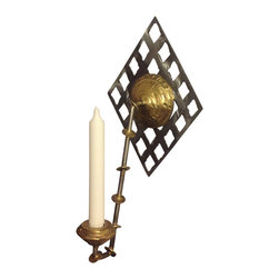 Handmade by artist - Candle wall sconce - Uniquely designed with modern lines and curves, this wall sconce is a stunning addition to your home. The handmade candleholder, by artist Joseph Tubman, adds the glow of candlelight to a striking wall sculpture.