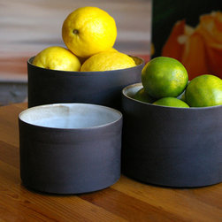 Black and White Nesting Bowls - These simply beautiful earthenware nesting bowls are elegant and unusual.  They are each slip-cast by hand in black clay and the outside is left unglazed, offering a unique tactile and visual contrast between the matte exterior and the light glossy white interior.  Fired at stoneware temperature, they are food-safe, dishwasher and microwave safe. The nature of the clay and Diana's technique make each item distinctly unique, giving each a personality of it's own.  Handmade in South Africa.