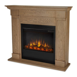 "Real Flame - Lowry Slim Series Electric,door Fireplace, Blonde Oak - Part of Real Flame's Slim Series, the Lowry mantel is the next generation of electric fireplaces with a mounting depth of only 9.3"" it provides a realistic, built-in look. The features include remote control, programmable thermostat, timer function, brightness settings and ultra bright Vivid Flame Led technology. Available in Vintage Black Maple and Blonde Oak. The Vivid Flame Electric Firebox plugs into any standard outlet for convenient set up. For safety, this unit must be anchored to a wall using the included hardware."