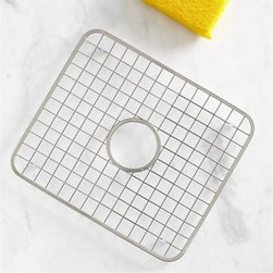 Stainless Steel Sink Grid with Hole - Nonslip and rustproof, this footed stainless grid with satin finish gets between the sink and the contents to limit dishwashing damage to your dinnerware, stemware, pots and sink surface. Outfitted with a central drainage hole.