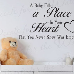Decals for the Wall - Wall Decal Sticker Quote A Baby Fills Your Heart Nursery Crib Baby's Room K98 - This decal says ''A baby fills a place in your heart that you never knew was empty''