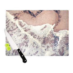 """Kess InHouse - Nastasia Cook """"Heart in the Sand"""" Beach Cutting Board (11.5"""" x 15.75"""") - These sturdy tempered glass cutting boards will make everything you chop look like a Dutch painting. Perfect the art of cooking with your KESS InHouse unique art cutting board. Go for patterns or painted, either way this non-skid, dishwasher safe cutting board is perfect for preparing any artistic dinner or serving. Cut, chop, serve or frame, all of these unique cutting boards are gorgeous."""