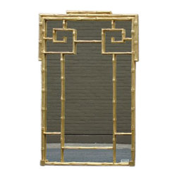 Chinese Gold Bamboo Mirror - A golden classic that still looks fresh today, this mirror would add a touch of glam to any space.