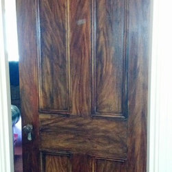 custom faux woodgrain - this antique oak door was a found piece in the customer's attic.  it had layers of paint on it.  we sealed it, primed it and painted it to match other oak doors in the home.