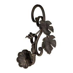 The Merchant Source - 1 1/4 in. Drapery Bracket - Grape Vine Design - Set of 2 (Black) - Finish: Black. Available in your pick of impressive finish colors, this pair of grape vine drapery brackets show meticulous attention to detail at every turn. Made of everlasting forged metal, each bracket has graphic scrolls and a delicate leaf motif. Profiled wall mounts complete the look. Set of 2. Made of Forged Metal. 3.5 in. and 6 in. return. 8 in. L x 6 in. W x 11 in. H (3 lbs.)
