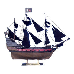 Handcrafted Nautical Decor - Blackbeard's Queen Anne's Revenge Limited 7'' - Wooden Model Pirate Ship - Pira - SOLD FULLY ASSEMBLED--Ready for Immediate Display - Not a Model Ship kit--Set sail across the Caribbean and imagine the exciting Golden Age of Piracy with Handcrafted Model Ships' stunning 7'' Limited Queen Anne's Revenge model. Handcrafted in a delightful size, this amazingly detailed model fits perfect atop any desk or shelf. Enjoy the fine craftsmanship and rich history of this legendary pirate ship, and feel the might of its terrifying captain - Blackbeard!------ ----    Amazingly Detailed      features      include:     --    --        Wooden hull, masts and spars--        Thread rigging for all sails--        Rope ladders ascending both       masts--        Hand-painted with many details--    --    --    Arrives fully      assembled with      all sails mounted and rigging taut--    Meticulously painted by hand--