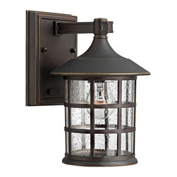 "Hinkley - Country - Cottage Hinkley Freeport 9 1/4"" High Bronze Outdoor Wall Light - Inspired by traditional design this cast aluminum outdoor wall light boasts clean lines and a matte black finish. Clear seedy glass adds a decorative touch to the grid style housing. A rectangular back plate and straight arm hold the fixture to the wall. From the Hinkley Lighting Freeport Collection. Cast aluminum outdoor wall light. Oil-rubbed bronze finish. Clear seedy glass. Maximum 75 watt or equivalent bulb (not included). UL listed for damp locations. 9 1/4"" high. 6"" wide. Extends 7"" from the wall. Backplate is 6"" high 4 1/2"" wide. Mounting point to top of fixture is 2 1/2"".  Cast aluminum outdoor wall light.  Oil-rubbed bronze finish.   Clear seedy glass.  Maximum 75 watt or equivalent bulb (not included).  UL listed for damp locations.  9 1/4"" high.  6"" wide.  Extends 7"" from the wall.  Backplate is 6"" high 4 1/2"" wide.  Mounting point to top of fixture is 2 1/2""."