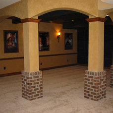 Traditional Home Theater by Buckland Construction, Inc.
