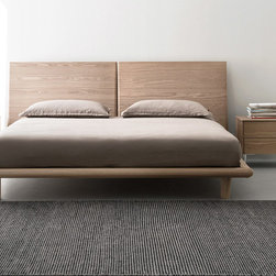 Sierra Bed by Calligaris - The Sierra Bed by Calligaris features a wooden frame and headboard with clean lines to add décor to any bedroom in the house. Available in standard King and Queen sizes with multiple finishes available. Wood finishes are either Natural wood (as pictured) or a darker Smoked wood. Matching wooden legs are an option for customers, or they can choose to hard metal legs.