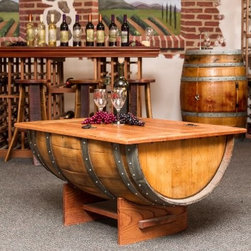 Napa East Wine Barrel Coffee Table - The Napa East Wine Barrel Coffee Table is not only a fun, character-filled table that wine enthusiasts will love, it also is quite functional. Crafted of a reclaimed French wine barrel, this appealing coffee table's solid clear white oak top lifts to reveal a storage area that's great for blankets, books, magazines and other living room items.About Napa EastNapa East creates wine-inspired furnishings that are made from actual reclaimed oak wine barrels. Their barrels began life handcrafted with pride from the finest French and American Oaks, and Napa East continues that theme when they hand-select barrels and giving them new life as beautiful one-of-a-kind works of art.