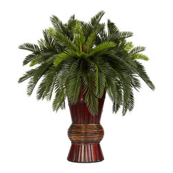 "Nearly Natural - Cycas w/Bamboo Vase Silk Plant - Standing at a majestic 29"", this vibrant Cycas is sure to draw an appreciative eye in any type of environment.  Simple to care for, but always well maintained, this ""Old World"" style plant will provide a lasting impression for a very long time.  This Cycas is only further complimented by its distinctive bamboo vase, which adds a true taste of the Orient to any gathering."