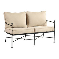 Ballard Designs - Castellon Loveseat - Coordinates with our Castellon Outdoor Seating. Sand colored box edge cushion included. Charcoal finish. Fully assembled. Replacement cushions available. Castellon Loveseat requires 2 replacement cushion sets.. The simple, sculptural lines and timeless details of our Castellon Outdoor Loveseat whisper relaxation with effortless style. Wrought iron frame is fully welded for enduring strength and powder-coated to resist moisture, chipping and rust.Castellon Loveseat features: . . . . . Use of an outdoor furniture cover is recommended to extend the life of your piece. Made in USA.