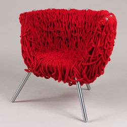 Vermelha chair | Campana Brothers Select - This chair will take everyone by surprise. While it looks like a mass of string it's actually a steel structure with hand-woven and dyed cotton rope. This piece incorporates many aspects of weaving: intertwined threads form the ropes, which are then hand-woven into upholstery. Five hundred meters of red cotton ropes are used to create these random looking loops, but, in reality, there is a structured method in the rather chaotic padding.