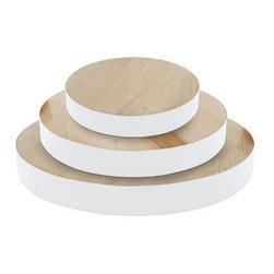 Round Chopping Board with White Painted Edge - The latest interpretation of the dipped trend is applying paint in unexpected places, as seen on these chunky chopping boards with white edges. They'd make great serving platters or bases for floral arrangements.