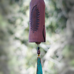 "Backyard Garden Art - This handmade mixed clay garden bell features a beautiful carved pattern of a fern leaf, accented by a large copper wind-sale with a patina finish. A small sculptured clay bird sits atop. My wind chimes serve so many purposes, besides just beautiful garden décor. They alert you to the severity of the wind that day, will scare off birds and animals that you don't want in your garden, and will create a peaceful, zen-like sound for the outdoors with it's wooden clapper (hear their sound on the YouTube clip below). Makes a perfect wedding or housewarming gift. Unglazed stoneware clay fired to 2200 degrees makes it very durable. Bell length 6 1⁄2 to 7 1⁄2"". Total length 13"" to 14"". 2 1⁄2"" W. 6"" hanging chain included. Handmade in the USA."