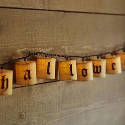 Happy Halloween String Lights - Our burlap lights spell out the sentiment of the evening in Gothic script. 10' long Happy Halloween is spelled out in Gothic script on burlap shades on a strand of 20 string lights. Two-prong plug-in. Catalog / Internet Only.