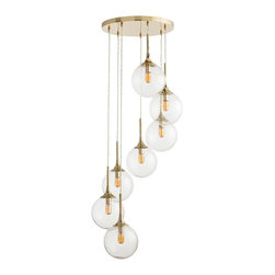 Arteriors - McKinley Fixed Chandelier, Polished Brass/Seedy Glass - Seven glass spheres spiral downward from the large round polished canopy in Polished Brass or Brown Nickel, seemingly to float through the air.  Polished Brass chandelier has seedy glass.  Brown Nickel chandelier has Smoke Glass.  Perfect for any vertical space that needs drama and sparkle.  Shown with radio bulbs.