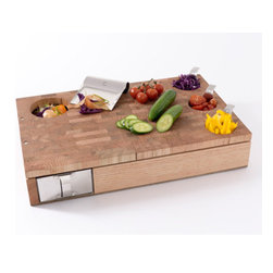 Workbench Cutting Board - This sturdy chopping block features recessed areas for mise en place and waste disposal. A new generation of this model is coming out soon.