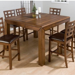 Jofran Enfield 7 piece Square Counter Height Dining Set - The Enfield 7 pc. Rectangular Dining Set has cabin-like style that rises to counter height in both its chairs and table. Constructed of premium Asian hardwood with a lovely walnut finish each piece in this set flows together beautifully. Includes six counter height chairs and a perfectly square table with self-storing butterfly leaf. Additional Information: Chair Dimensions: 18W x 22D x 41H inches Table Dimensions: 42-54L x 54W x 36H inches About Jofran FurnitureJofran is a seller of fine home furnishings based in Norfolk Mass. Launched In 1986 Jofran is known for the high-quality materials and meticulous methods that go into producing its products. Jofran furniture is easy-to-assemble and includes various styles from all around the world making it easy to find a piece that suits your home decor.