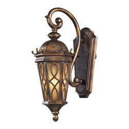 """Elk - Montreal Park Amber 18"""" High Outdoor Wall Light - The fine craftsmanship is evident in the cast aluminum details and scrollwork. The Amber Scavo glass is enhanced by a swirled pattern with a hazelnut bronze finish. Although it looks antique it functions like a modern light with ample light output. Welcome guests with this charming entrance lantern. Cast aluminum. Hazelnut bronze finish. Amber Scavo glass. Takes one 60 watt candelabra bulb (not included). 7"""" wide. 18"""" high. Extends 10"""" from wall.  Cast aluminum.  Hazelnut bronze finish.   Amber Scavo glass.  Takes one 60 watt candelabra bulb (not included).  7"""" wide.  18"""" high.   Extends 10"""" from wall."""