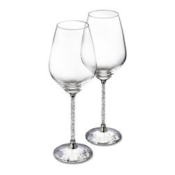 Swarovski - Swarovski Crystalline White Wine Glasses Set - SwarovskiCrystalline White Wine Glasses Set  -  Size: 3.4 Inches Wide x 8.9 Inches Tall  -  Hand Crafted In Fine Swarovski Silver Crystal  -  Made In Austria  -  Make your dining experience a memorable one with this set of 2 modern and sophisticated white wine glasses. Their stems are filled with clear crystals for a sparkling effect and the base is made of a large faceted clear crystal.