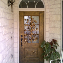 Forged Iron Entry Door - Galvanized forged iron entry door with grape leaf design, model F1-3002. Insulated glue chip glass insert panel is hinged, and opens to the inside. Ideal for entries with direct exposure to sunlight. For expert advice call us 877-929-3667.