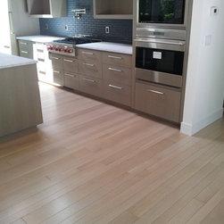 Custom Rift/ Quartersawn White Oak Plank - Custom PREFINISHED Whitewashed Rift & Quartersawn Oak Plank flooring installed in a high end residential project.